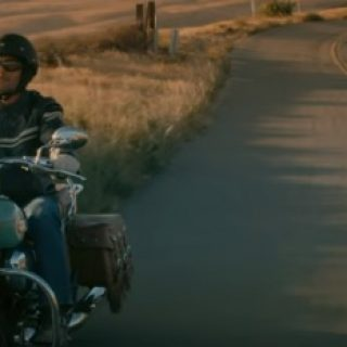 Redhead in geico motorcycle commercial almost