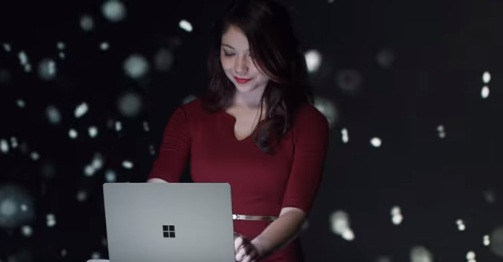 Woman in Microsoft Surface Laptop Commercial