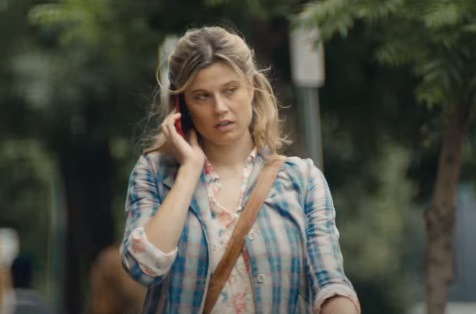 Apple Girl Fumbling and Dropping Her iPhone 12 on the Sidewalk Commercial