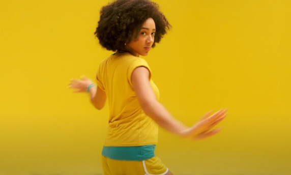 Vitl Roller-Skating Girl in Yellow Outfit Advert
